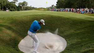 Martin Kaymer hits a bunker shot on the 12th during the third round