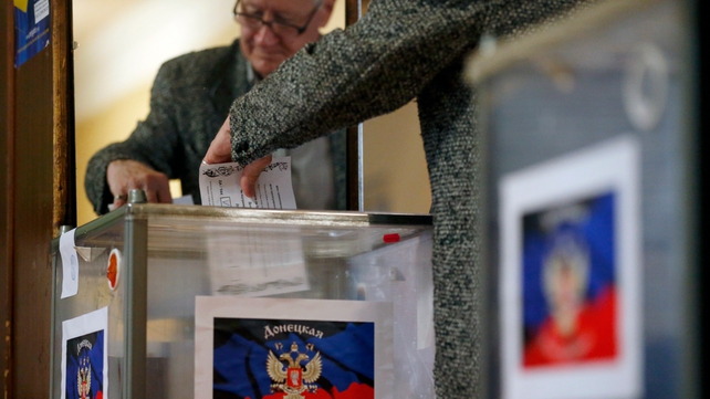 A Ukrainian man casts his ballot at a polling station in Donetsk