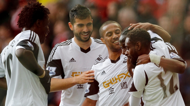 Marvin Emnes celebrates with his team-mates after scoring Swansea's second