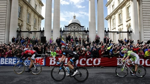 Giant-Shimano's Marcel Kittel (left) passes Government Buildings on Merrion Street after crossing the finish line to win stage three of the 2014 Giro d'Italia on Sunday