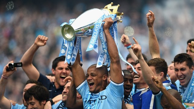 Vincent Kompany of Manchester City lifts the Premier League trophy last May