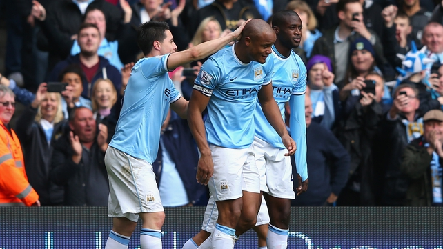Vincent Kompany is congratulated by his team-mates after scoring the second goal against West Ham