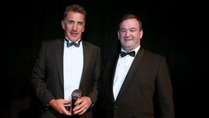 Munster's Rob Penney is presented with his award by of RaboDirect PRO12 CEO John Feehan