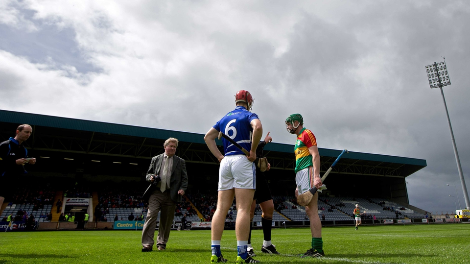 The Laois and Carlow captains look on  as the ref tosses the coin ahead of their Leinster SHC clash