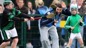 Hurler Eamon Dillon gets a block in during Dublin GAA's open night in Parnell's
