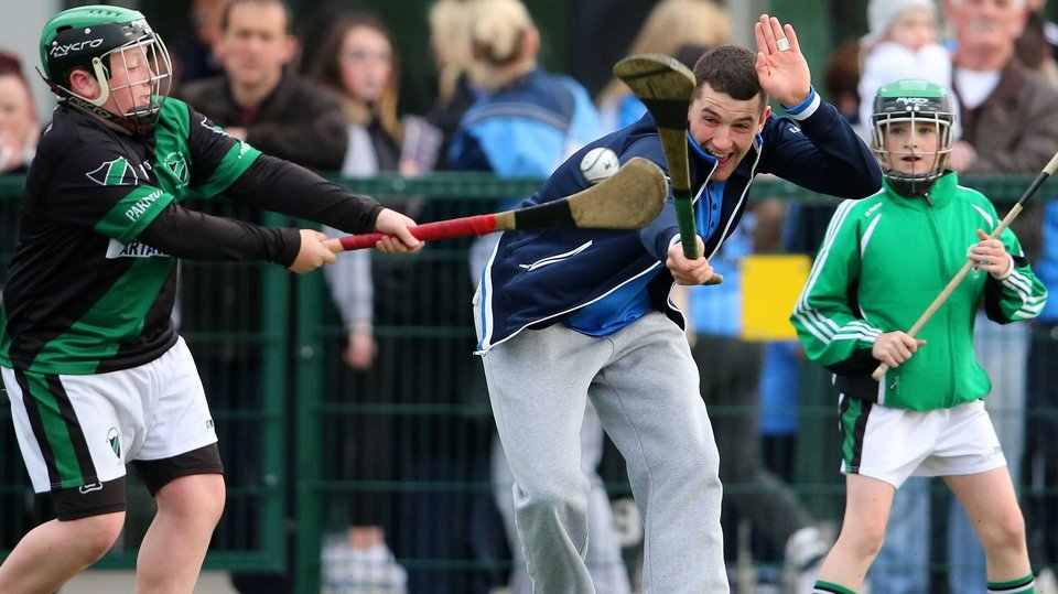 Hurler Eamon Dillon gets a block in during Dublin GAA's open night in Parnell's