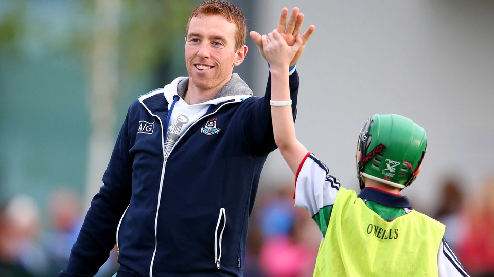 John McCaffrey high fives a young fan at Dublin GAA's open night