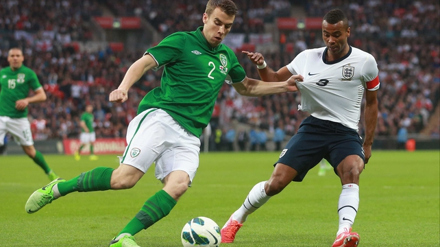 Ashley Cole (R) in action against Ireland's Seamus Coleman