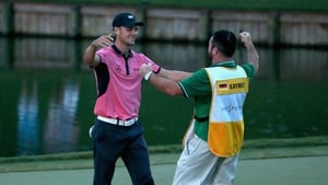 Martin Kaymer celebrates victory with his caddy