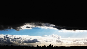 A dark cloud develops over Auckland in New Zealand