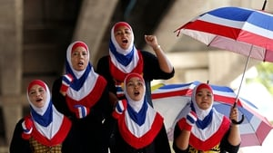 Thai Muslim anti-government protesters wear national colours and shout slogans during a street rally in Bangkok
