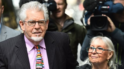 Rolf Harris arrives with his wife Alwen Hughes at Southwark Crown Court in central London