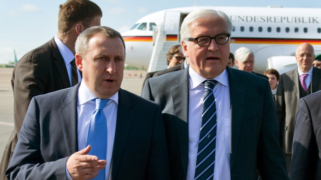 Frank-Walter Steinmeier (right) was greeted by Ukrainian Foreign Minister Andrei Deshchytsia