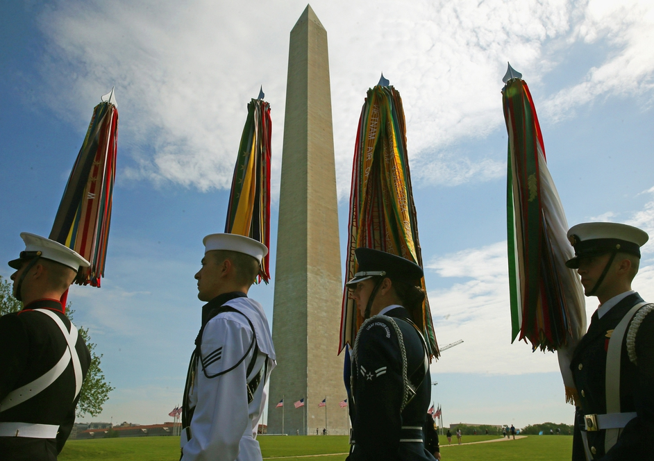A military honour guard participates in the reopening ceremony at the Washington Monument in Washington, DC.
