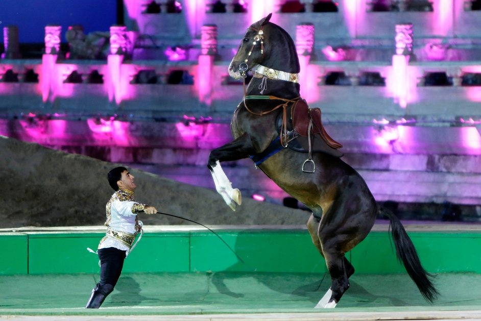 A Turkmenistan man and his horse perform during the opening ceremony of China Horse Culture Festival 2014 at Forbidden City, in Beijing,China