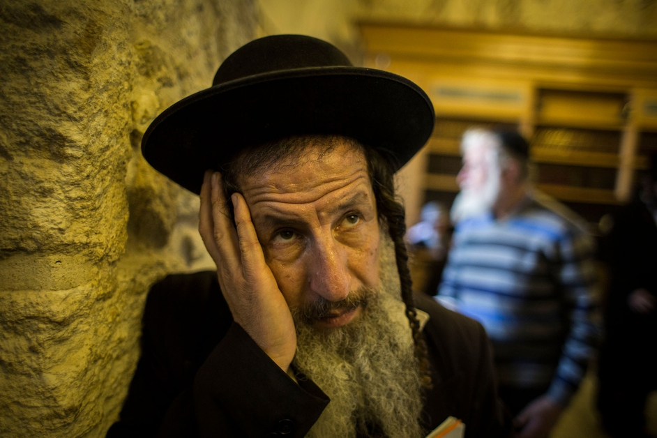 Ultra Orthodox Jew prays by the 'Tomb of King David' before a rally started outside the site in Jerusalem, Israel.