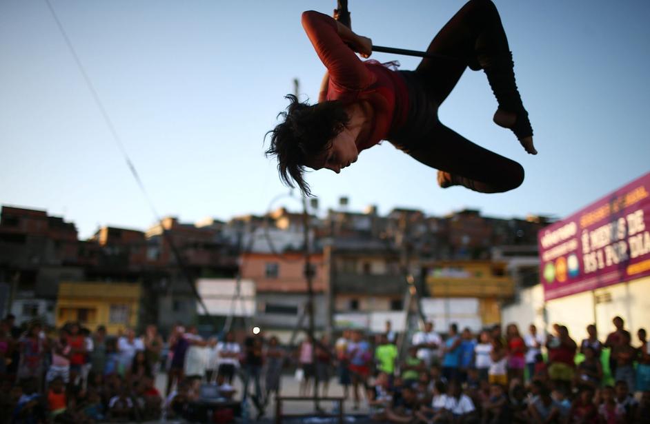An artist from the Cia Base circus group performs during the International Circus Festival in the Vila Cruzeiro slum, or favela, in Rio de Janeiro, Brazil.
