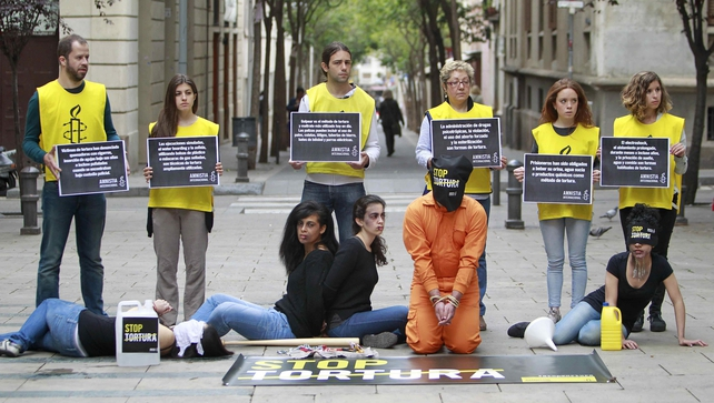 Members of Amnesty International take part in a 'Stop Torture' campaign rally in Barcelona, Spain