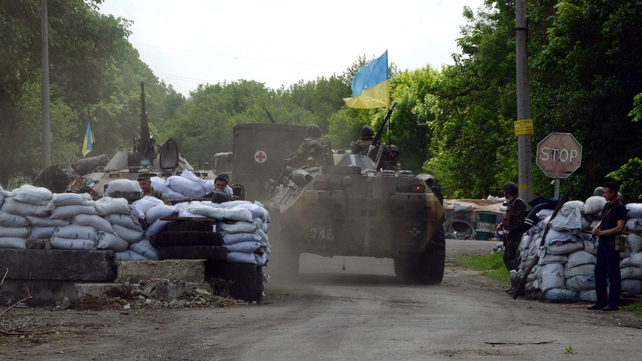 Ukrainian soldiers take position at a checkpoint near the eastern Ukranian city of Slaviansk