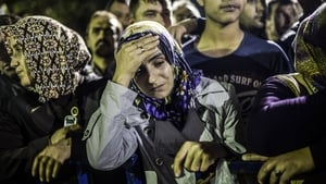 People wait for news of their relatives as hundreds of miners were trapped after an explosion in a Turkish mine