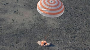 They returned to earth in a Russian Soyuz TMA-11 space capsule and landed in Dzhezkazgan in Kazakhstan