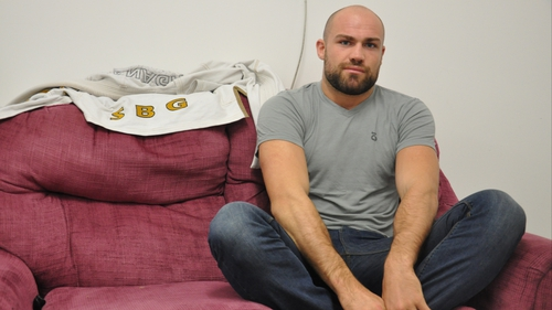 Cathal Pendred sits cross-legged in the changing rooms of his gym in West Dublin