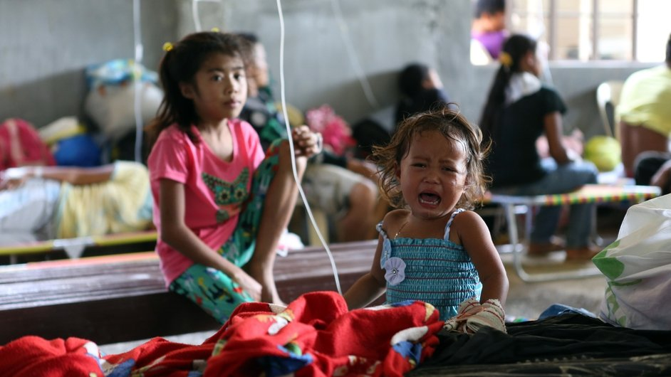 Children suffering from cholera are treated inside a hospital in Alamada, Mindanao in the Philippines