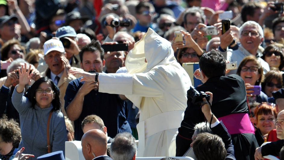 Pope Francis greets the crowd as he arrives for his general audience in St Peter's Square at the Vatican