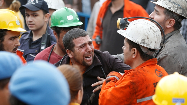 People mourn for their relatives after the mine explosion in Soma
