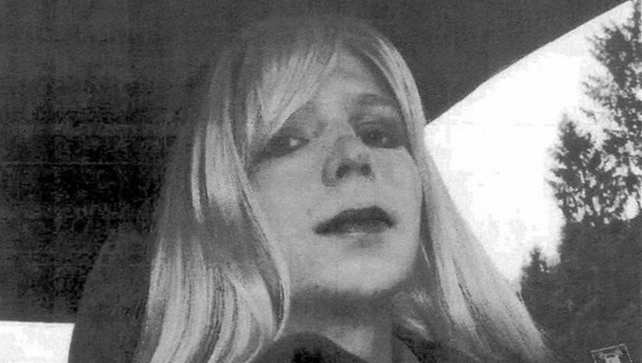 A US Army handout shows Chelsea Manning wearing a long blonde wig and lipstick