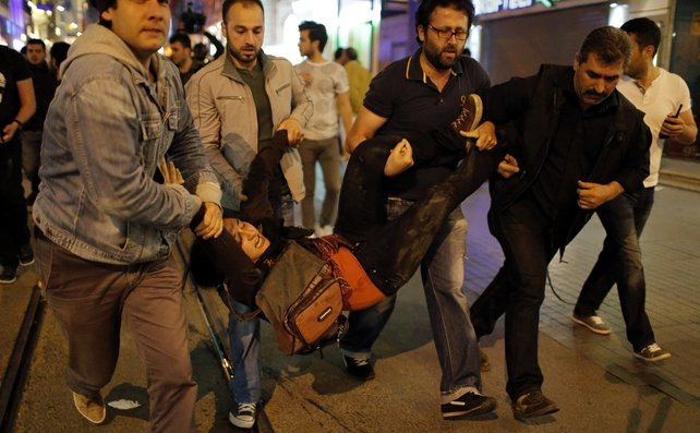 Turkish police arrest a protester during a demonstration for the victims of the mine explosion