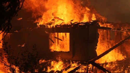 A house is destroyed by fire in Carlsbad in California