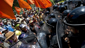 Thai anti-government protesters face off with the military as they try to storm a meeting in Bangkok