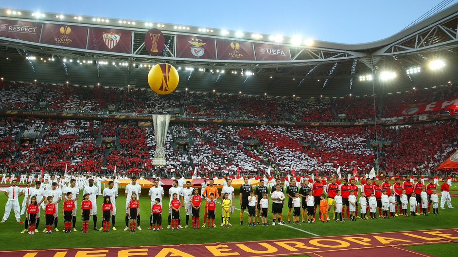 Sevilla and Benfica players line up before the start of the Europa League final in Turn. Sevilla won on penalties.
