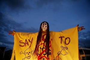 A protestor celebrates aftar a gas-drilling company had its permit suspended in Lismore, Australia