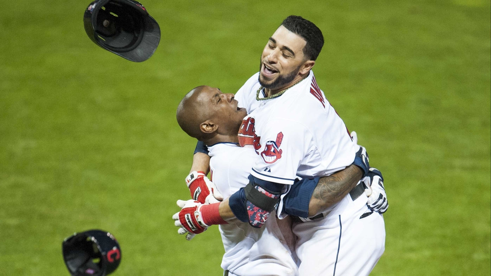 Nyjer Morgan and Mike Aviles of the Cleveland Indians celebrate after Aviles hits a walk-off single to defeat the Minnesota Twins
