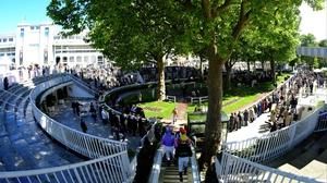 Jockeys make their way to the parade ring at Longchamp