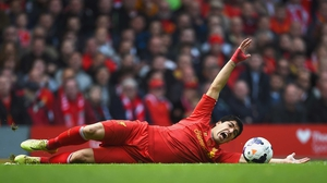 Liverpool's Luis Suarez strikes a dramatic pose during his side's victory over Newcastle