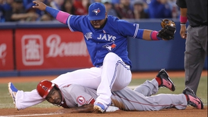 Toronto Blue Jays' Juan Francisco  falls on Howie Kendrick of the Los Angeles Angels of Anaheim at Rogers Centre in Toronto