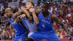 You shall not pass - Blake Griffin of the Los Angeles Clippers is strong-armed by Oklahoma City Thunder's Serge Ibaka and Caron Butler