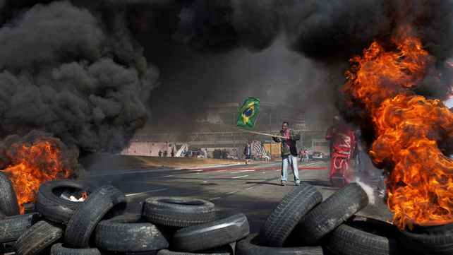 Protesters set fire to tyres on the road to the World Cup stadium in Sao Paulo