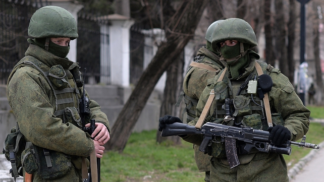 Russian soldiers patrol outside the navy headquarters in Simferopol on the Crimean peninsula in recent month