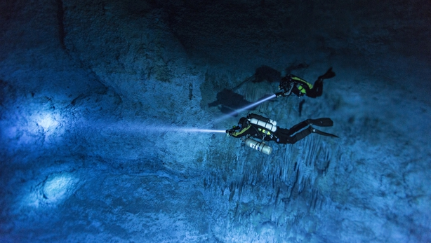 Divers Susan Bird and Alberto Nava search the walls of Hoyo Negro