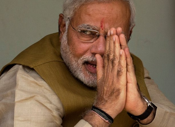 Narendra Modi gestures to his supporters