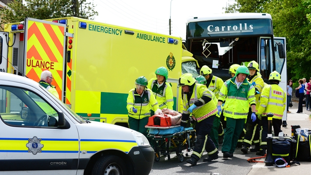 Emergency services with a casualty at the scene