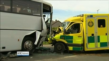 Man in a serious condition following crash between bus and ambulance