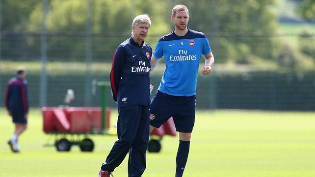 Per Mertesacker with Arsenal manager Arsene Wenger