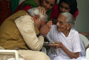 India's Prime Ministe elect Narendra Modi takes blessings from his mother Heeraben