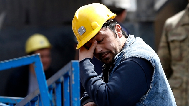 A miner rests during the rescue operation