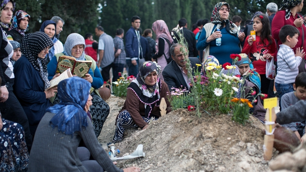 Relatives gather at the grave of one of the miners killed in the disaster